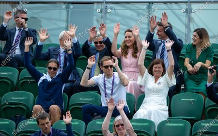 Britain's Catherine, The Duchess of Cambridge, Patron of the All England Lawn Tennis Club takes part in a Mexican wave on No.3 Court with her father Michael Middleton (L) and Scott Lloyd LTA Chief Executive (R), during the Gordon Reid of Britain and Joachim Gerard of Belgium match in the final of the Gentlemen's Wheelchair Singles at TheThe Wimbledon Championships, in Wimbledon, Britain, 11 July 2021.