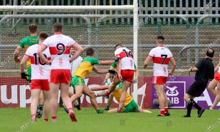 Stock Photo of Derry vs Donegal. Donegal's Michael Murphy blocks a goal attempt from Shane McGuigan of Derry