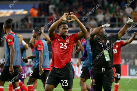 Trinidad and Tobago midfielder Jesse Williams (23) reacts to fans after the tied with Mexico during a CONCACAF Gold Cup Group A soccer match in Arlington, Texas