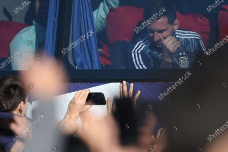 The Argentine national team player Lionel Messi smiles at the fans who greet him outside the bus that transports the team, after its arrival in Buenos Aires, Argentina, 11 July 2021. Hundreds of people received this Sunday he Argentine team, champion of the Copa América 2021. Argentina beat Brazil 1-0 in the final of the Copa América with a goal from Ángel Di María at the Maracaná stadium in Rio de Janeiro and, With this 15th continental trophy, Argentina ends a 28-year titleless fast.