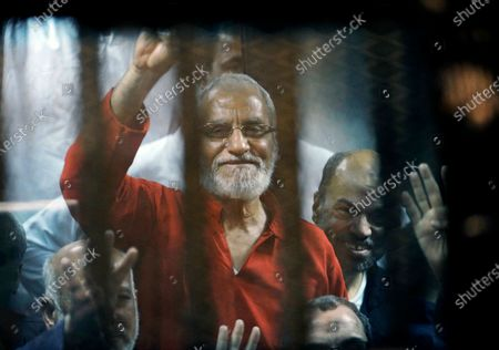 Muslim Brotherhood spiritual leader, Mohammed Badie waves from a defendants cage in a makeshift courtroom at the national police academy, in eastern Cairo, Egypt. On, Egypt's highest appeals court upheld the sentencing of ten leaders of Egypt's outlawed Muslim Brotherhood, including Badie, to life imprisonment, the state-owned MENA news agency reported. In 2019, a Cairo criminal court found all ten guilty of charges related to killing policemen and organizing mass jail breaks during Egypt's 2011 uprising