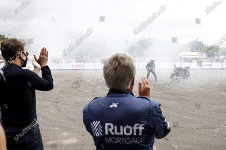 Stock Picture of Tom Cruise and Mario Andretti watching the Terry grant Stunt performance  during the 2021