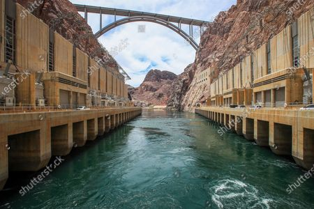 A view of water flowing in the outflow area at the bottom of Hoover Dam, where water is released back into the Colorado River and looking up to the Mike O'Callaghan-Pat Tillman Memorial Bridge Tuesday, June 29, 2021. The lower water levels are reducing the power that Hoover Dam's electrical turbines generate. Aaron said that because we are in the 22nd year of drought, contingency plans were signed in 2019 and are working. The agency determines water allocation in August for 2022, and could declare a shortage for the first time in history. If so, Arizona will have water reduction by 18 percent, Nevada reduced by 7 percent, and Mexico by 5 percent. Lake Mead is at its lowest level in history since it was filled 85 years ago. The ongoing drought has made a severe impact on Lake Mead and a milestone in the Colorado River's crisis. High temperatures, increased contractual demands for water and diminishing supply are shrinking the flow into Lake Mead. Lake Mead is the largest reservoir in the U.S., stretching 112 miles long, a shoreline of 759 miles, a total capacity of 28,255,000 acre-feet, and a maximum depth of 532 feet. (Allen J. Schaben / Los Angeles Times)