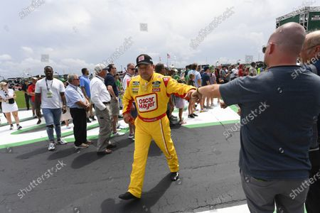 Ryan Newman interacts with a fan before a NASCAR Cup Series auto race, in Hampton, Ga