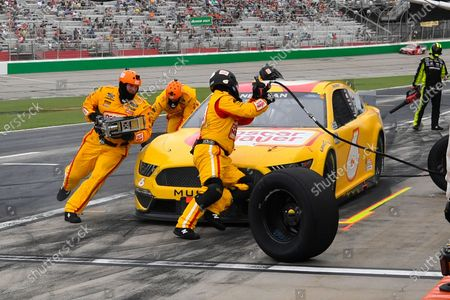 Ryan Newman makes a pitstop during a NASCAR Cup Series auto race, in Hampton, Ga