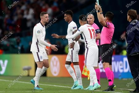 England's Marcus Rashford, 2nd left, replaces teammate England's Jordan Henderson, left, during the Euro 2020 soccer championship final match between England and Italy at Wembley stadium in London