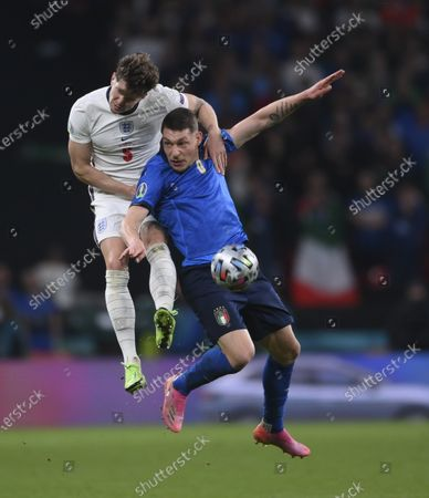 England's John Stones, left, and Italy's Andrea Belotti jump for the ball during the Euro 2020 soccer final match between England and Italy at Wembley stadium in London