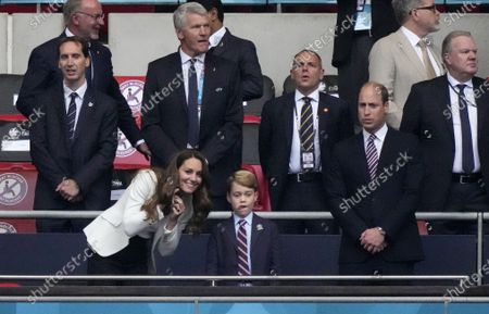 Prince William, his son Prince George and Duchess Catherine, from right, stand on the tribune prior the Euro 2020 soccer championship final between England and Italy at Wembley stadium in London