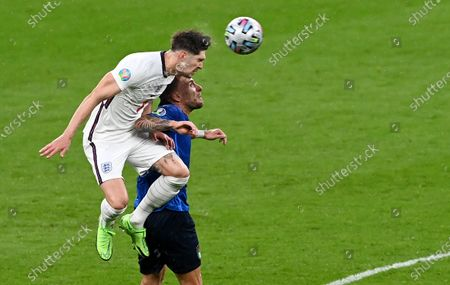 Ciro Immobile (R) of Italy in action against John Stones of England during the UEFA EURO 2020 final between Italy and England in London, Britain, 11 July 2021.
