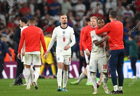 Jordan Henderson (C) of England and teammates react after the penalty shoot-out of the UEFA EURO 2020 final between Italy and England in London, Britain, 11 July 2021.