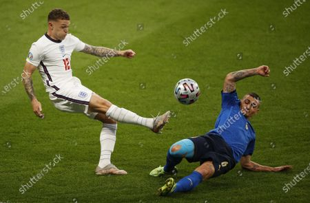 Marco Verratti (R) of Italy in action against Kieran Trippier of England during the UEFA EURO 2020 final between Italy and England in London, Britain, 11 July 2021.