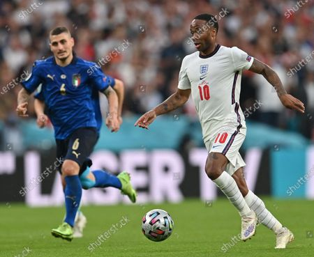Raheem Sterling (R) of England in action against Marco Verratti of Italy during the UEFA EURO 2020 final between Italy and England in London, Britain, 11 July 2021.