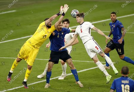 Goalkeeper Gianluigi Donnarumma (L) of Italy in action against John Stones of England during the UEFA EURO 2020 final between Italy and England in London, Britain, 11 July 2021.