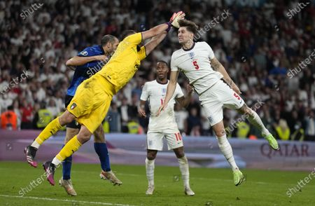 Goalkeeper Gianluigi Donnarumma (L) of Italy in action against John Stones (R) of England during the UEFA EURO 2020 final between Italy and England in London, Britain, 11 July 2021.
