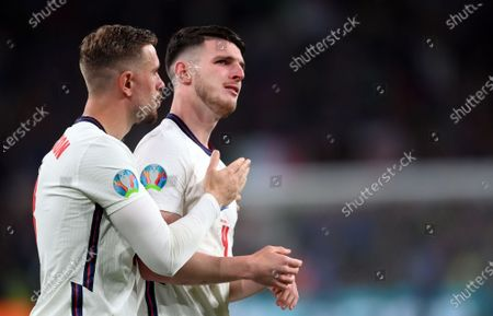 Declan Rice (R) and Jordan Henderson react after losing the UEFA EURO 2020 final between Italy and England in London, Britain, 11 July 2021.