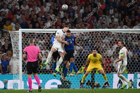England's John Stones, top left, heads the ball past Italy's Emerson Palmieri during the Euro 2020 soccer final match between England and Italy at Wembley stadium in London