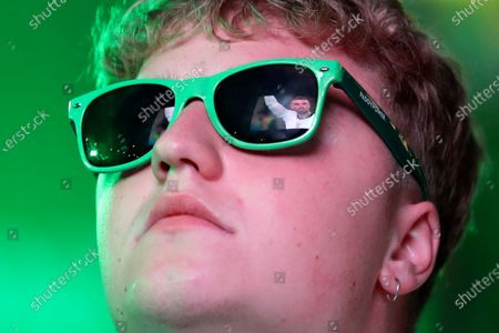 English player Jordan Henderson is reflected in an English supporter's sunglasses at a fan zone in Newcastle, England, during the Euro 2020 soccer championship final match between England and Italy at Wembley Stadium in London
