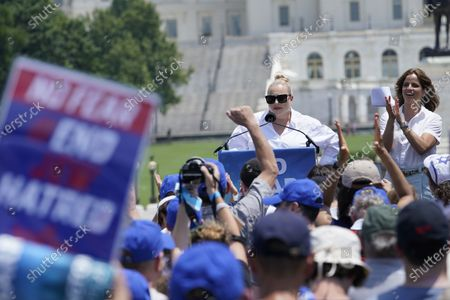 """Stock Picture of Meghan McCain speaks at the """"NO FEAR: Rally in Solidarity with the Jewish People"""" event in Washington, as Israeli actress Noa Tishby applauds at right. The event is co-sponsored by the Alliance for Israel, Anti-Defamation League, American Jewish Committee, B'nai B'rith International and other organizations"""