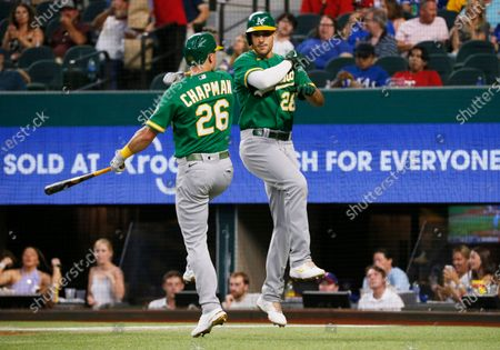 Oakland Athletics' Matt Olson, right, body bumps Matt Chapman, left, after hitting a solo home run against the Texas Rangers during the fourth inning of a baseball game in Arlington, Texas