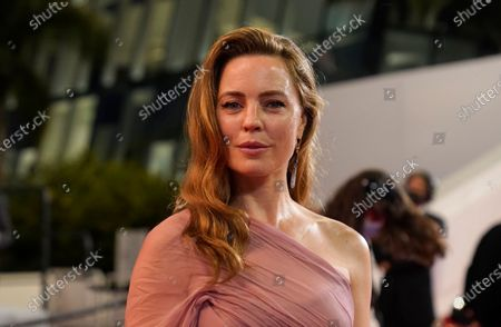 Melissa George poses for photographers upon arrival at the premiere of the film 'Bergman Island' at the 74th international film festival, Cannes, southern France