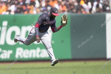Stock Photo of Washington Nationals left fielder Josh Harrison (5) makes the catch on a fly ball hit by San Francisco Giants' Mike Yastrzemski during the sixth inning of a baseball game, in San Francisco