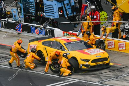 Ryan Newman makes a pit stop during a NASCAR Cup Series auto race, in Hampton, Ga