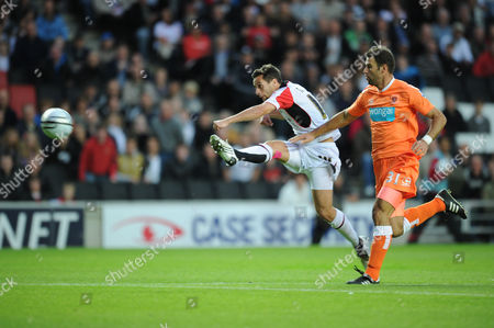 Sam Baldock of MK Dons scores against Blackpool as Dekel Keinan of Blackpool attempts to stop his shot