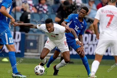 Canada defender Mark-anthony Kaye (14) and Martinique midfielder Romario Barthelery (22) chase the ball during the first half of a CONCACAF Gold Cup soccer match, in Kansas City, Kan