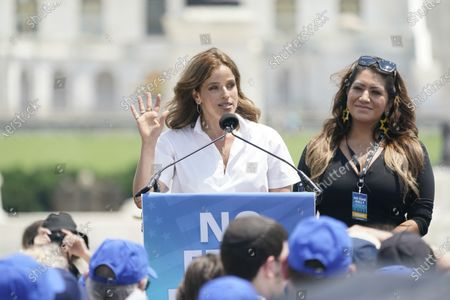 """Noa Tishby, actress, activist and author of """"Israel: A Simple Guide to the Most Misunderstood Country on Earth,"""" makes remarks at the """"No Fear: A Rally in Solidarity with the Jewish People"""" on the National Mall in Washington, DC. At right is Alma Hernandez."""