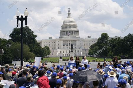 """Stock Image of Noa Tishby, actress, activist and author of """"Israel: A Simple Guide to the Most Misunderstood Country on Earth,"""" left, makes remarks at the """"No Fear: A Rally in Solidarity with the Jewish People"""" on the National Mall in Washington, DC. Looking on are Alma Hernandez, center and Meghan McCain, right."""