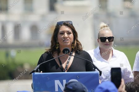 """Alma Hernandez, Arizona State Representative who championed Arizona's Holocaust Education Bill, left, speaks at the """"No Fear: A Rally in Solidarity with the Jewish People"""" on the National Mall in Washington, DC. Looking on is Meghan McCain, right."""