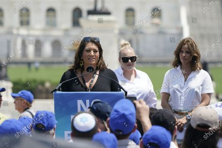 """Alma Hernandez, Arizona State Representative who championed Arizona's Holocaust Education Bill, left, speaks at the """"No Fear: A Rally in Solidarity with the Jewish People"""" on the National Mall in Washington, DC. Looking on are Meghan McCain, center, and Not Tishby, right."""