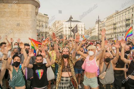 """Stock Picture of The high temperatures, of about 40 degrees, did not prevent about a thousand people yesterday, according to data from the Government Delegation, from demonstrating at eight o'clock in the afternoon in the Puerta del Sol in defense of the group of lesbians, gays, transsexuals and bisexuals (LGTBI) and to protest the murder of the young Samuel Luiz that occurred on Sunday, July 3, next to the Riazor beach, in A Coruña.The concentration called by various associations for the defense of the LGTBI collective began at eight o'clock in the afternoon and in it you could see dozens of rainbow flags and banners in which you could read """"Homophobia and fascism are the same"""" or """"Justice for Samuel ! Murderers, all, to the judge â€�. Chants were also chanted such as """"It was not for a motive, it was for a fag"""" - referring to the reasons for the murder of Samuel Luiz -, """"I'm also a shit fag"""" or """"murderers, murderer"""", in addition to proclamations against Vox the extreme right: """"Franco is not dead, he is in Congress.""""One of the attendees, Gerardo Matarranz, explained that yesterday's rally was the continuation of the one registered last Monday and on this occasion it sought to silence all groups that deny the homophobic nature of the murder of the young A Coruña. """"The atmosphere has been unanimous against this idea,"""" added this young man.The organizers read a statement at the end in which they denounced """"the continuous harassment"""", """"violence"""" and """"fear"""" suffered by the group. â€oeEnough of attacks and deaths. Not one more. We are together and organized â€�, highlighted the final writing, which was read to continuous ovations from the attendees. â€oeThey killed Samuel for being a fag,â€� the organizers repeated on several occasions."""