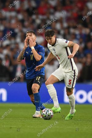 """John Stones (England)Ciro Immobile (Italy)                     during the Uefa  """"European Championship 2020 Finals match between  Italy 4-3 England  at Wembley Stadium in London, England."""