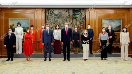 """Spain's King Felipe, centre, poses with Spain's new ministers and other ministers affected by a cabinet re-shuffle after the swearing in ceremony at the Zarzuela Palace in Madrid, Spain, . Spanish Prime Minister Pedro Sanchez has overhauled his Cabinet to form what he calls """"the government of the recovery"""" following the coronavirus pandemic. Pictured from left to right; Foreign Minister Jose Manuel Albares, Science and innovation Minister Diana Morant, 2nd deputy Prime Minister and Labour Minister Yolanda Diaz, Territorial Policy Minister Isabel Rodriguez, Education Minister Pilar Alegria, Prime Minister Pedro Sanchez, Finance Minister Maria Jesus Montero, King Felipe, Transport Minister Raquel Sanchez, Deputy Prime Minister and Economy Minister Nadia Calvino, Minister of the Presidency, Relations with the Cortes Felix Bolanos, 3rd Deputy Prime Minister and Minister for the Ecological Transition Teresa Ribera, Sports and Culture Minister Miquel Iceta and Justice Minister Pilar Llop"""