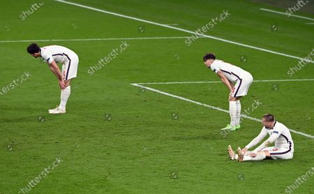 Stock Picture of Harry Maguire, John Stones and Luke Shaw of England dejected during the UEFA EURO 2020 final between Italy and England