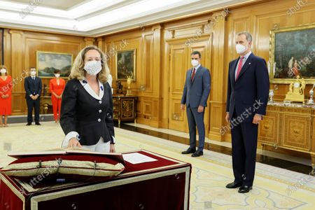 Spanish Economy Minister Nadia Calvino (L) swears in as First Deputy Prime Minister to have both posts next to Spain's King Felipe VI and Spanish Prime Minister Pedro Sanchez (2R) during the swearing-in ceremony of the new members of Spanish Cabinet at La Zarzuela Palace, in Madrid, Spain, 12 July 2021. Spanish Prime Minister Pedro Sanchez announced a deep change in his Cabinet aimed to boost economic recovery after the impact of COVID-19 pandemic.