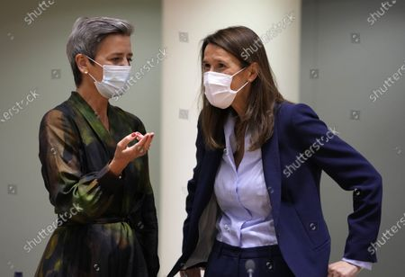Stock Image of European Commissioner for Europe fit for the Digital Age Margrethe Vestager, left, speaks with Belgium's Foreign Minister Sophie Wilmes during a meeting of EU foreign ministers at the European Council building in Brussels on