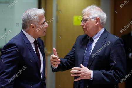 Israeli Minister of Foreign Affairs, Yair Lapid (L) and European Union foreign policy chief Josep Borrell attend a meeting of EU foreign ministers, at the European Council in Brussels, Belgium, 12 July 2021. EU foreign affairs minister will informally exchange views with the Israeli Minister of Foreign Affairs, Yair Lapid.