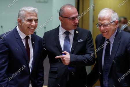 (L-R)  Israeli Minister of Foreign Affairs, Yair Lapid, Croatia's Foreign Minister Gordan Grlic Radman  and European Union foreign policy chief Josep Borrell attend a meeting of EU foreign ministers, at the European Council in Brussels, Belgium, 12 July 2021. EU foreign affairs minister will informally exchange views with the Israeli Minister of Foreign Affairs, Yair Lapid.