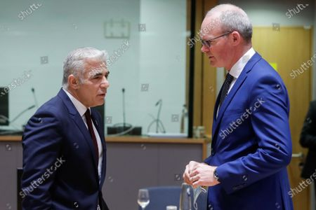 Israeli Minister of Foreign Affairs, Yair Lapid (L) and Ireland Minister of State for Foreign Affairs Simon Coveney  attend a meeting of EU foreign ministers, at the European Council in Brussels, Belgium, 12 July 2021. EU foreign affairs minister will informally exchange views with the Israeli Minister of Foreign Affairs, Yair Lapid.