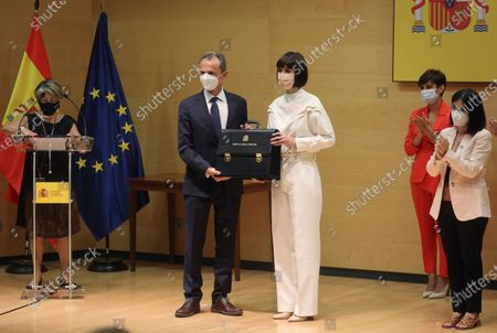 Stock Image of New Spanish Science and Innovation Minister Diana Morant (C-R) receives the Minister's portfolio from her predecessor Pedro Duque (C-L) during a ceremony at Science Ministry in Madrid, Spain, 12 July 2021. Spanish Prime Minister, Pedro Sanchez, announced a deep change in his Cabinet aimed to boost economic recovery after the impact of COVID-19 pandemic.