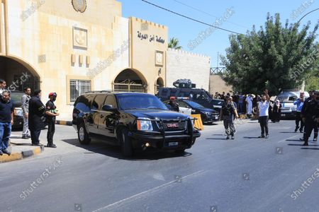 A car transporting former Jordanian royal adviser Bassem Awadallah (unseen) leaves the State Security Court after a verdict was announced in his trial alongside another official, accused of helping Prince Hamzah try to overthrow his half-brother King Abdullah II, in the capital Amman, Jordan, 12 July 2021. The court sentenced Awadallah and an ex-envoy to Saudi Arabia, Sharif Hassan bin Zaid, to 15 years in jail over a palace coup plot.