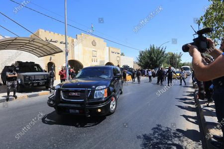 Stock Image of A car transporting former Jordanian royal adviser Bassem Awadallah (unseen) leaves the State Security Court after a verdict was announced in his trial alongside another official, accused of helping Prince Hamzah try to overthrow his half-brother King Abdullah II, in the capital Amman, Jordan, 12 July 2021. The court sentenced Awadallah and an ex-envoy to Saudi Arabia, Sharif Hassan bin Zaid, to 15 years in jail over a palace coup plot.