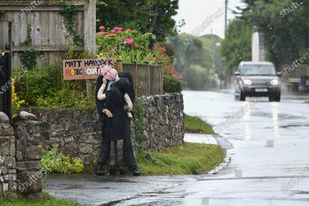 A scarecrow of Matt Hancock's moment with Gina Coladangelo has taken centre stage at a village competition in Southgate, Gower, Wales. The display which is visible to passers-by and part of the villages annual best dressed scarecrow competition, captures the embrace that ended the ministers job in the cabinet.