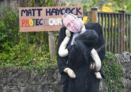 Stock Picture of A scarecrow of Matt Hancock's moment with Gina Coladangelo has taken centre stage at a village competition in Southgate, Gower, Wales. The display which is visible to passers-by and part of the villages annual best dressed scarecrow competition, captures the embrace that ended the ministers job in the cabinet.