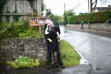 Stock Image of A scarecrow of Matt Hancock's moment with Gina Coladangelo has taken centre stage at a village competition in Southgate, Gower, Wales. The display which is visible to passers-by and part of the villages annual best dressed scarecrow competition, captures the embrace that ended the ministers job in the cabinet.