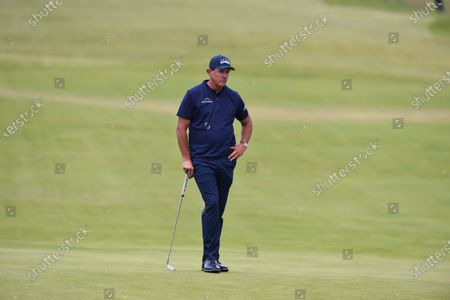 Phil Mickelson looks dejected on the 18th green as he shoots +10 for the first round