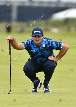 Patrick Reed on the 1st green