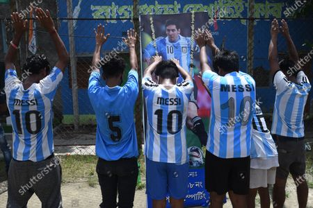 Football fans with posters of Lionel Messi celebrate Argentina's victory in COPA America 2021, on July 11, 2021 in Kolkata, India.